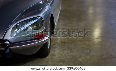 Detail of classic car. Close-up of headlight - stock photo
