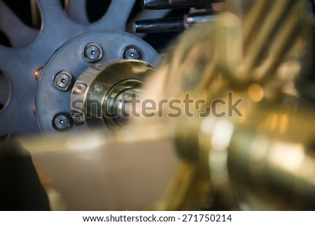 Detail of clock internal parts, blue and gold metal - stock photo