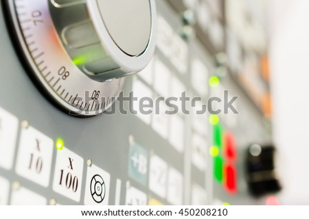 Detail of CNC machine control panel. Shallow depth of field. - stock photo