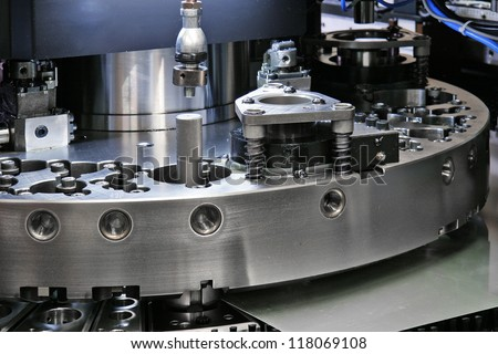 detail of CNC punching machine - stock photo