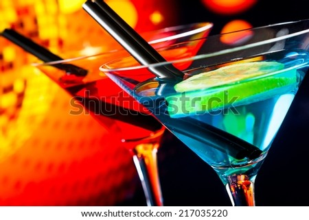 detail of cocktail with sparkling disco ball background with space for text, dance disco concept - stock photo