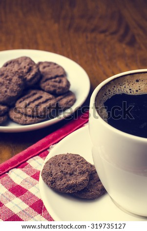 Detail of coffee and biscuits on a wooden table