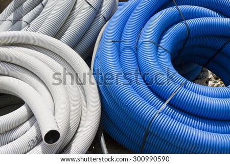 Detail of colored hose used in the construction industry - stock photo