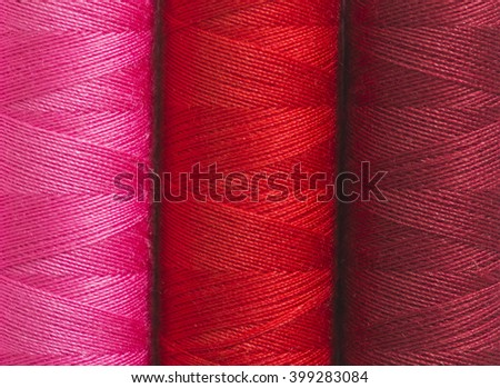 Detail of colored sewing threads. - stock photo