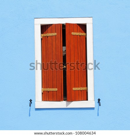 detail of colorful facade with window with ajar shutters, Burano, Venice, Italy, Europe - stock photo