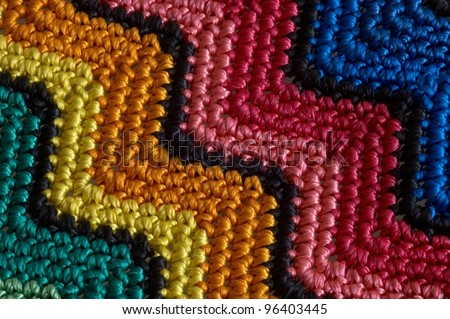 Detail of colorful knitted blankets pillows