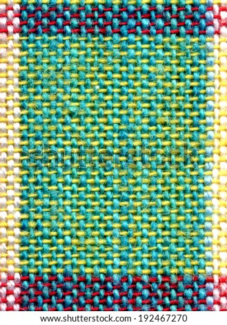 Detail of colorful square fabric pattern background.