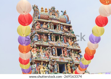 Detail of colorful Sri Mariamman temple, the oldest Hindu temple in Singapore. Located on South Bridge Road in the Chinatown District of Singapore. - stock photo