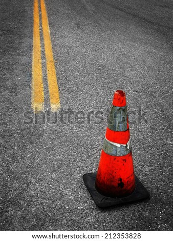 Detail of Construction Cone yellow street lines suggesting repair - stock photo