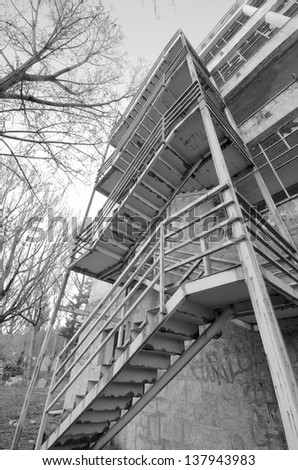 Detail of creepy stairs in an abandoned building in black and white