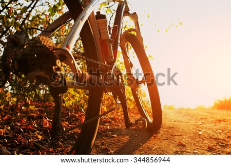 Detail of cyclist man feet riding mountain bike on outdoor trail on country road - stock photo