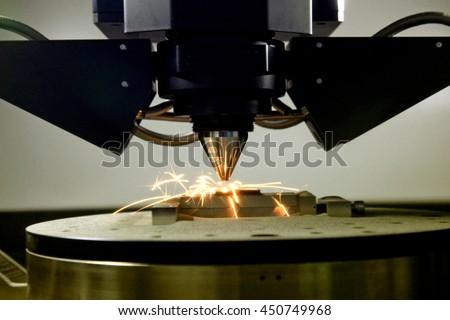 detail of 3d printer printing a metal piece - stock photo