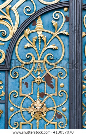 Detail of decorative blue doors with golden details. - stock photo