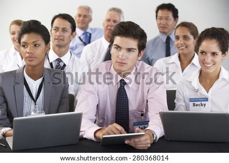 Detail Of Delegates Listening To Presentation At Conference - stock photo