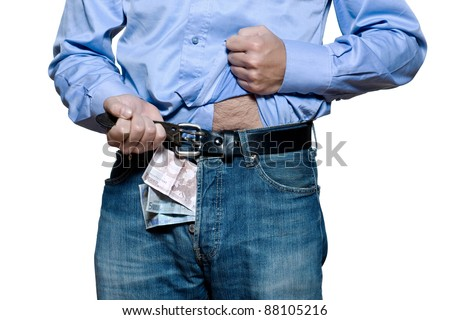 Detail of denim jeans with money inside in studio isolated on white background - stock photo
