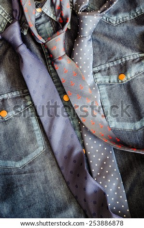 Detail of denim vintage shirt with three ties - stock photo
