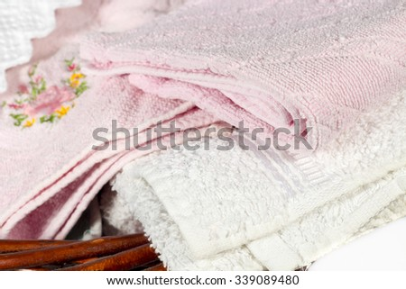 Detail of different hand towels on a wicker basket