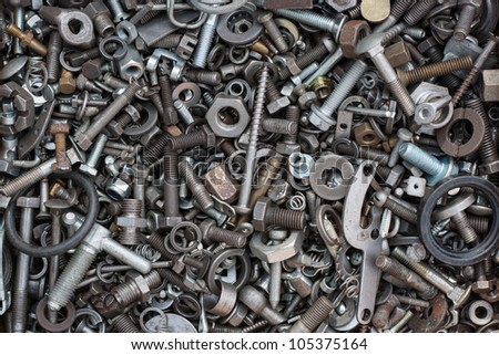 Detail of different metallic bolts and nuts - stock photo