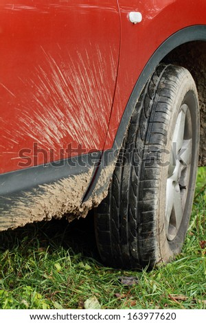 Detail of dirty off-road red car - stock photo