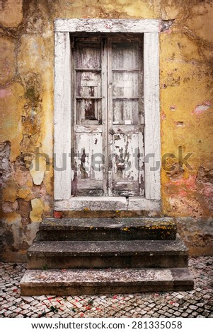 Detail of door and stair steps in an old yellow house ruin - stock photo