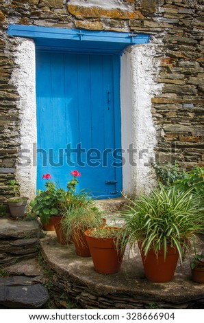 Detail of door in old stone house in a remote portuguese rural village - stock photo