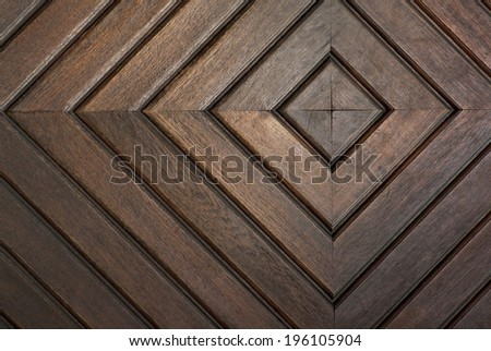 detail of door with concentric squares carved in wooden boards