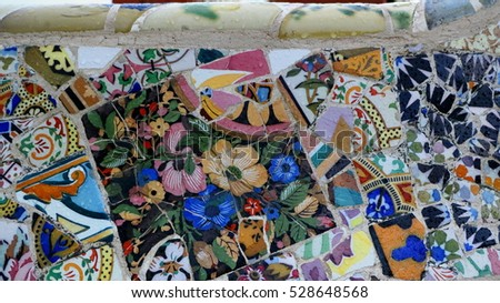 Detail of famous colorful bench of park Guell at rainyday, Barcelona, Spain