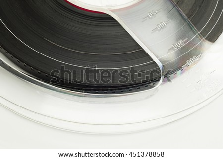 Detail of film reel on white isolated background.