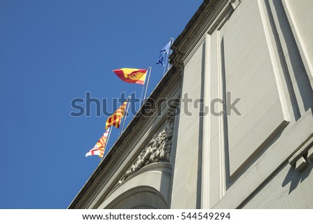 Detail of flags waving on top of France Station (Estacion de Francia) in Barcelona.