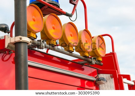 Detail of Flashing Red Siren Light on Roof of Emergency Vehicle. - stock photo