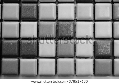 Detail of floor tiles useful as a background texture in black and white