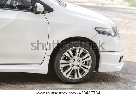 Detail of front car wheels, detail of car