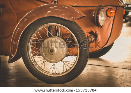 detail of front wheel of vintage car - stock photo