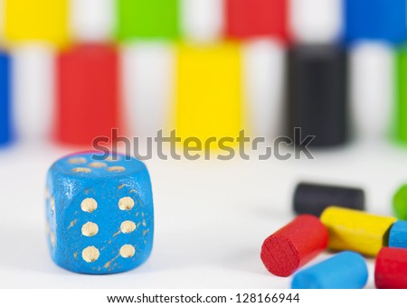 Detail of game cube with background of pieces - stock photo