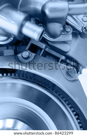 detail of gear in car engine. - stock photo