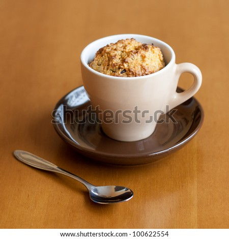 Detail of gluten free muffin in coffee cup on table