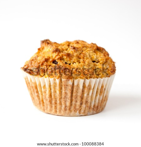Detail of gluten free muffin with nuts isolated on white background