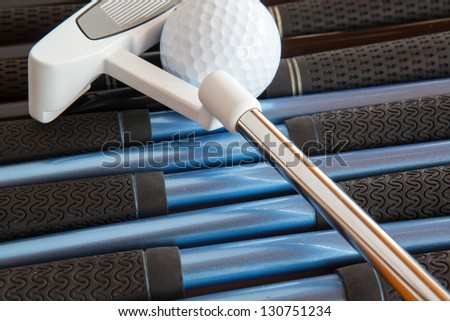 Detail of golf putter and different golf clubs - stock photo