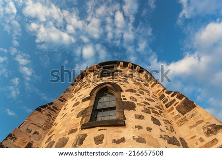 Detail of Gothic Tower at Calton Hill in Edinburgh, Scotland.  Calton Hill is popular hill in central Edinburgh included in UNESCO World Heritage Site list. - stock photo