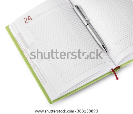Detail of green diary with pen isolated on white background