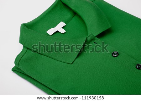 Detail of green polo shirt - stock photo