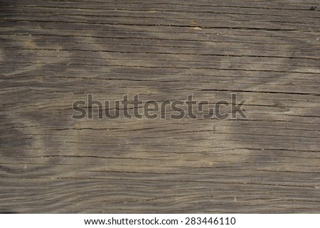 Detail of grit in wood grain and wave patterns. - stock photo