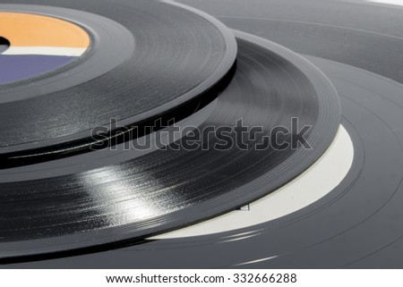 Detail of grooves on vinyl records of different sizes