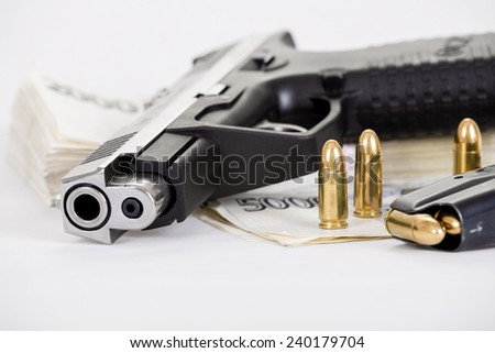detail of gun with bullet on czech banknotes background