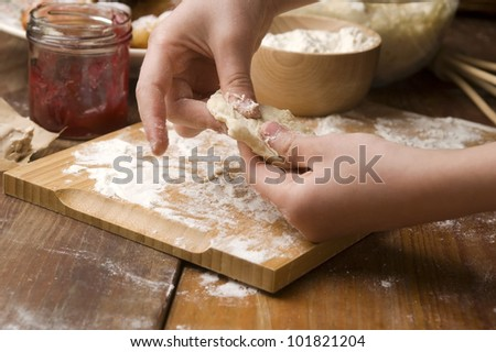 Detail of hands kneading dough - stock photo