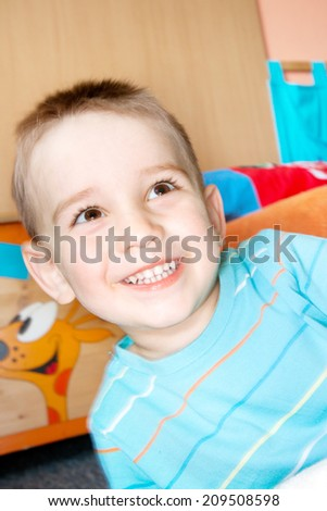 detail of happy face boy at home - stock photo