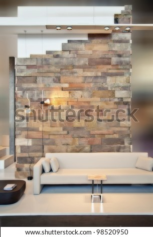 detail of home interior with brick wall - stock photo