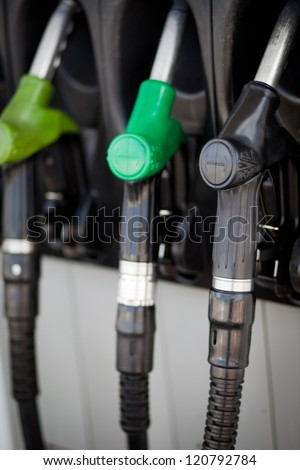 Detail of hoses of petrol pump at a gas station, selective focus - stock photo