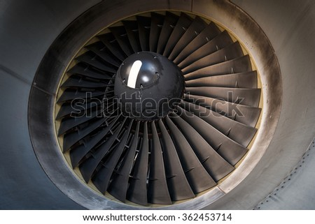 Detail of huge fanblade of airplane engine - stock photo