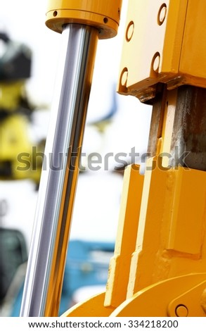 Detail of hydraulic bulldozer piston excavator arm construction machinery white background - stock photo